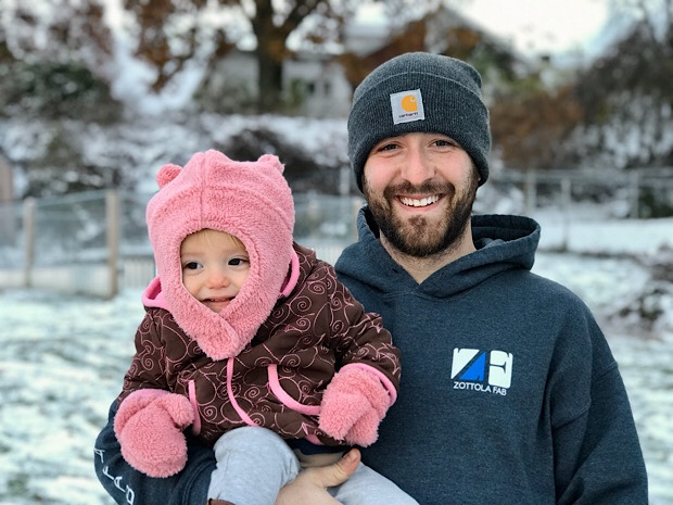 Father and baby in snow