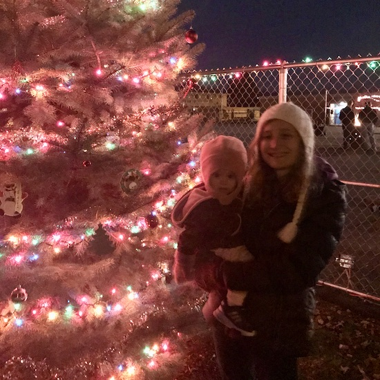 Mom and toddler with Christmas tree