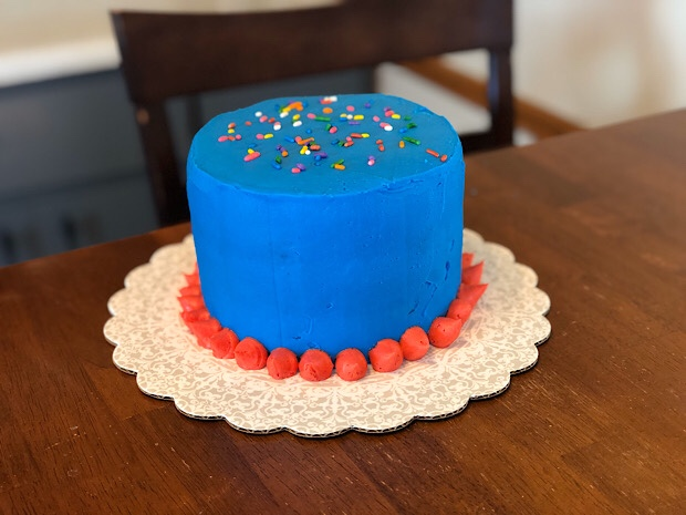Blue and red birthday cake with sprinkles