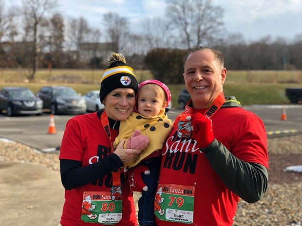 Grandparents at a 5k race with toddler