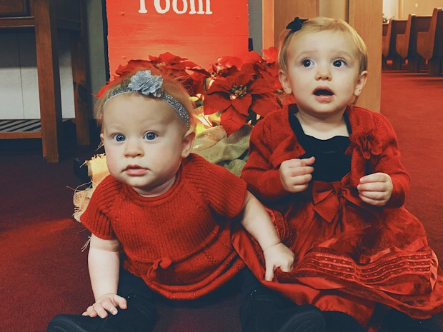 Baby girls in Christmas dresses