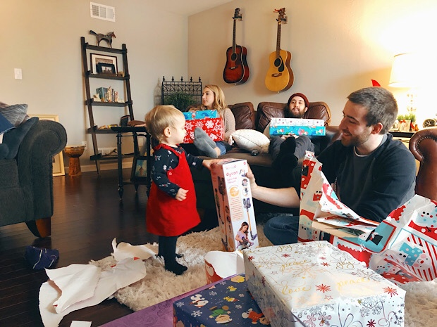 Baby opening gifts on Christmas Day