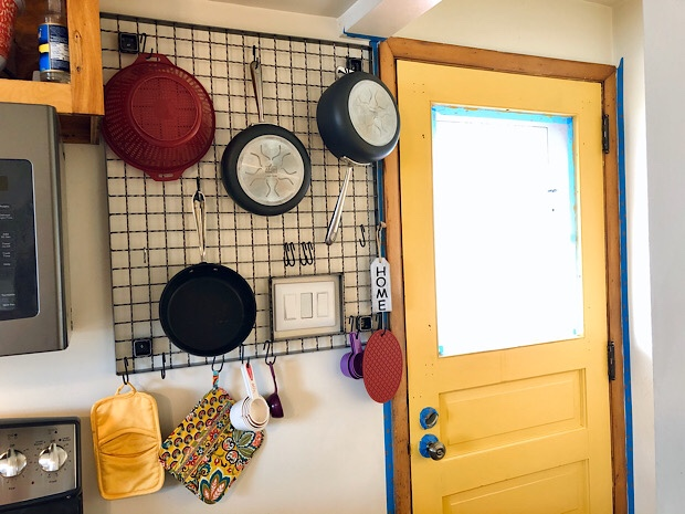 Rack to hang pots and pans in kitchen