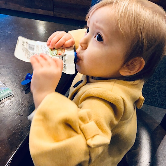 Baby eating pouch at Starbucks