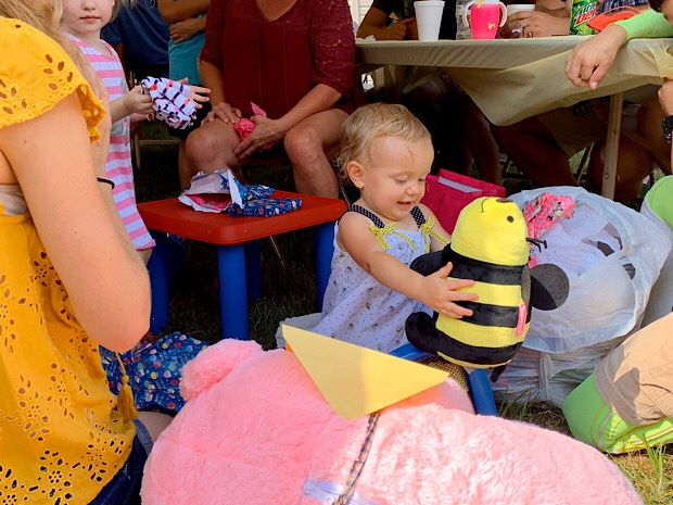 Baby with stuffed bumble bee