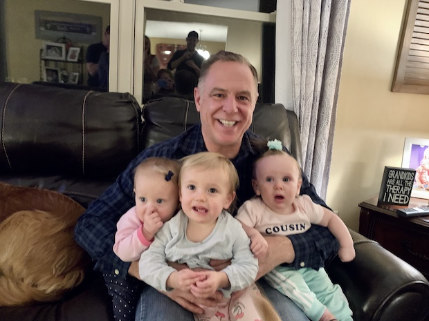 Grandpa with three babies