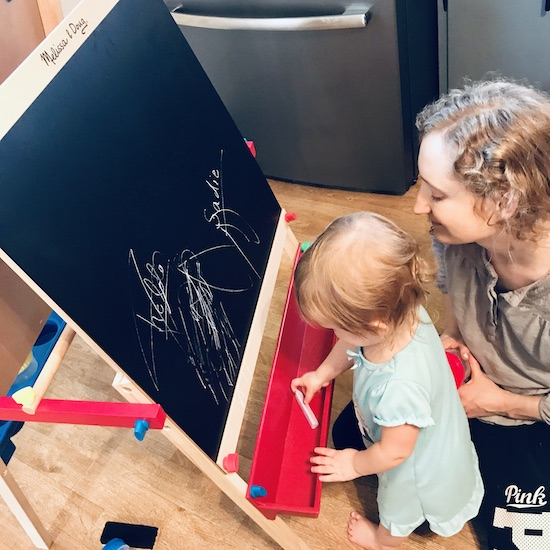 Mom and daughter drawing on easel by Melissa and Doug