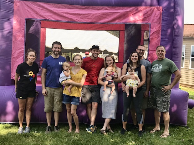 Family photo with bounce house