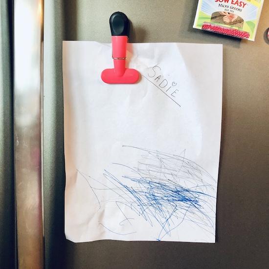 Toddlers drawing hanging on fridge