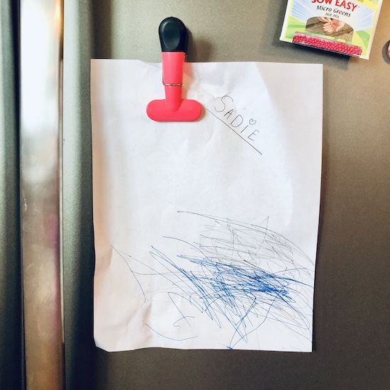 Toddlers drawing hanging on fridge