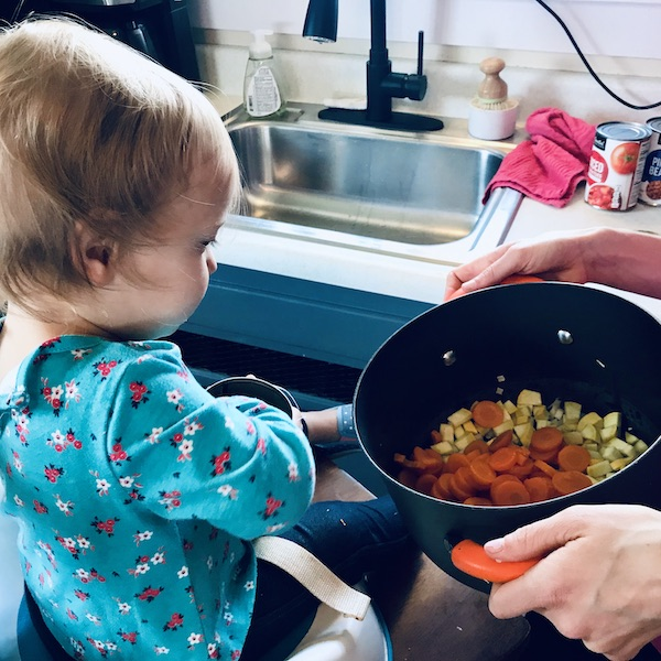 Cooking with toddler helping