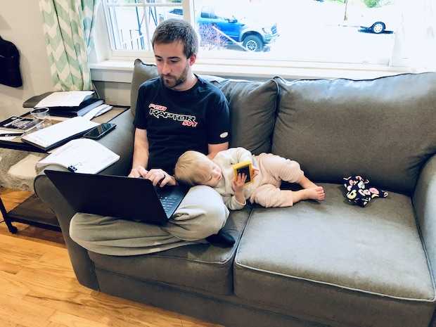 Dad and toddler on couch