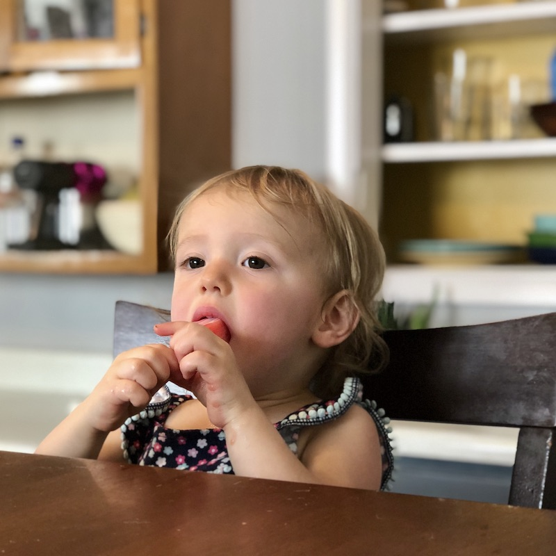 Toddler eating popsicle