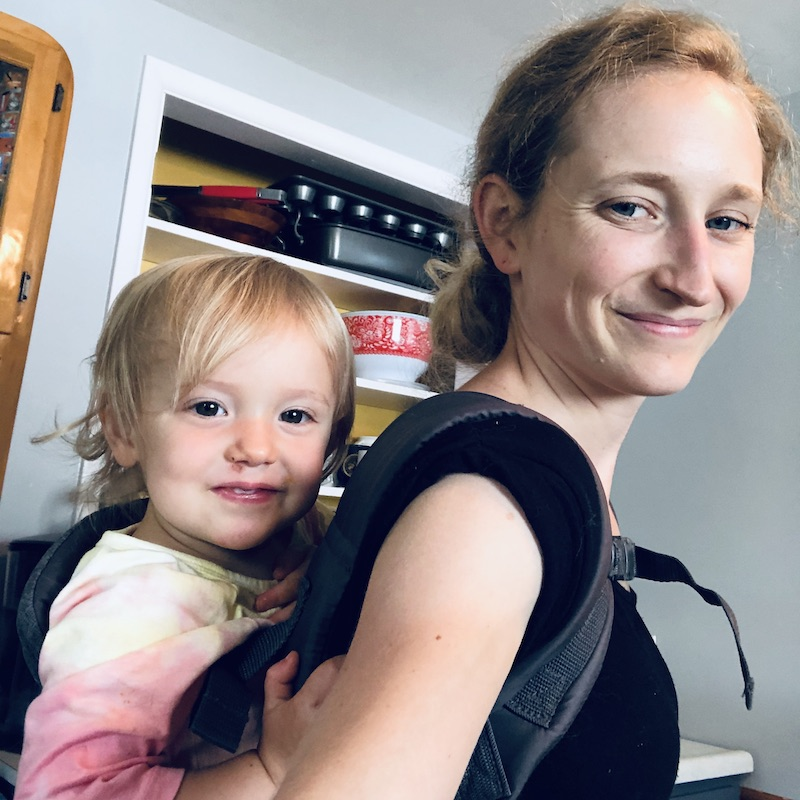 Toddler in baby carrier on back