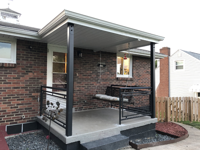 Back porch with black steel columns and black steel mesh railings