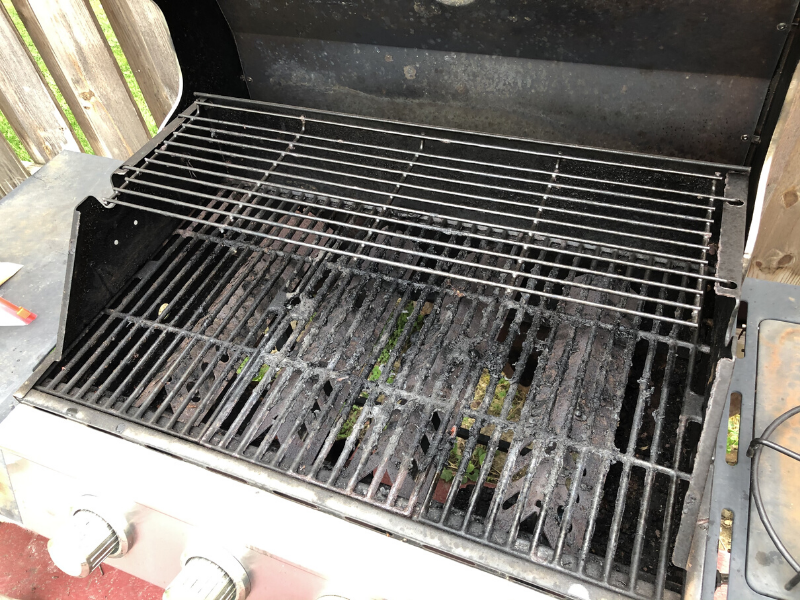 Gas grill with rusted out bottom
