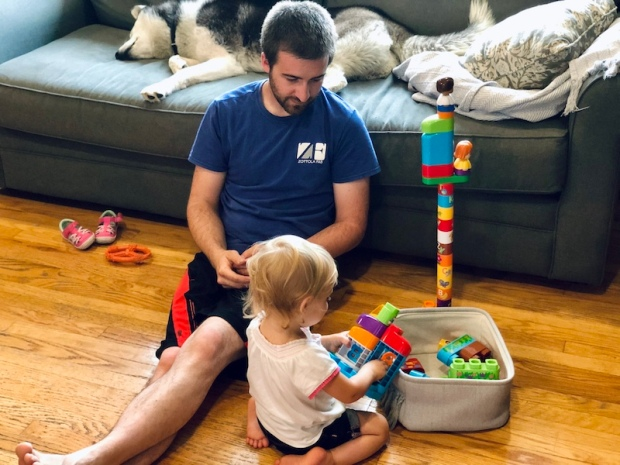 Dad and toddler playing with blocks