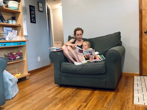 Mom reading books to toddler