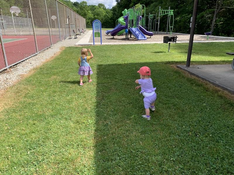 Toddlers walking at park