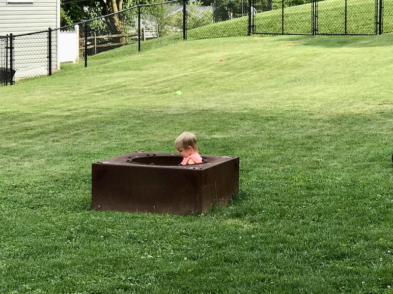 Toddler playing in fire pit