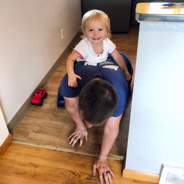 Toddler riding on dad's back