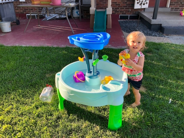 Toddler with water table