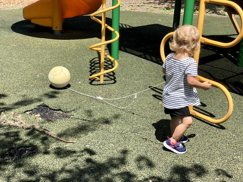 Toddler with tetherball