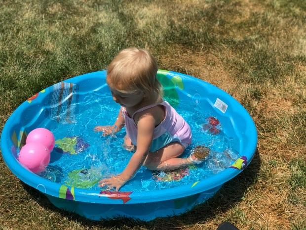 Toddler playing in baby pool
