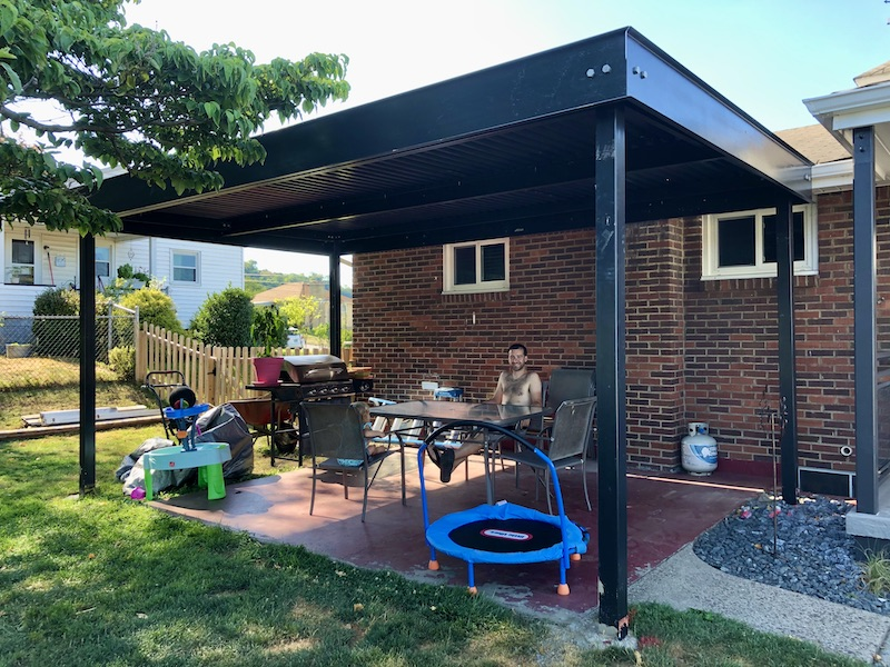 Black steel canopy for yard that looks industrial and modern
