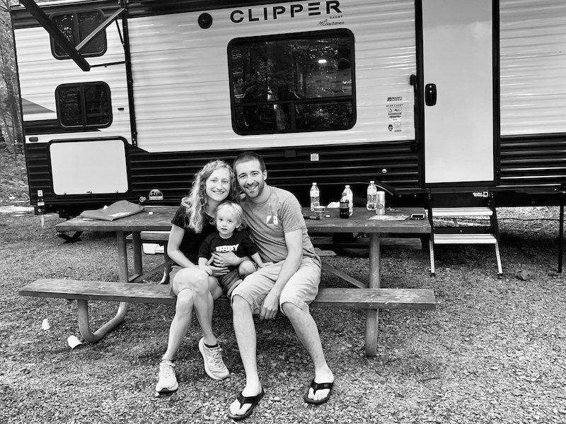 Family in front of camper at Ohiopyle State Park Campground