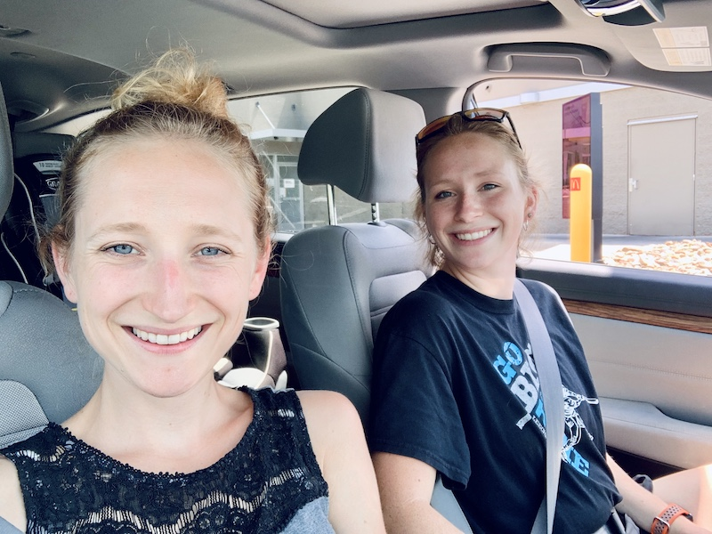 Sisters smiling together in car