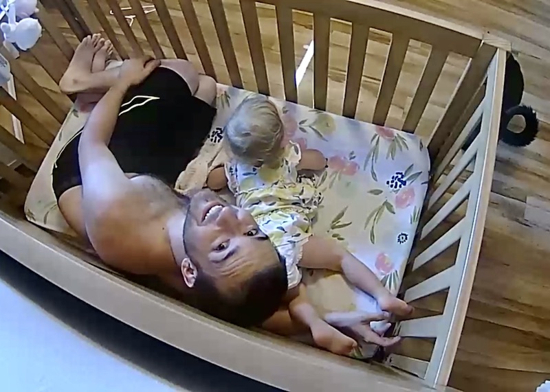 Dad in crib with baby