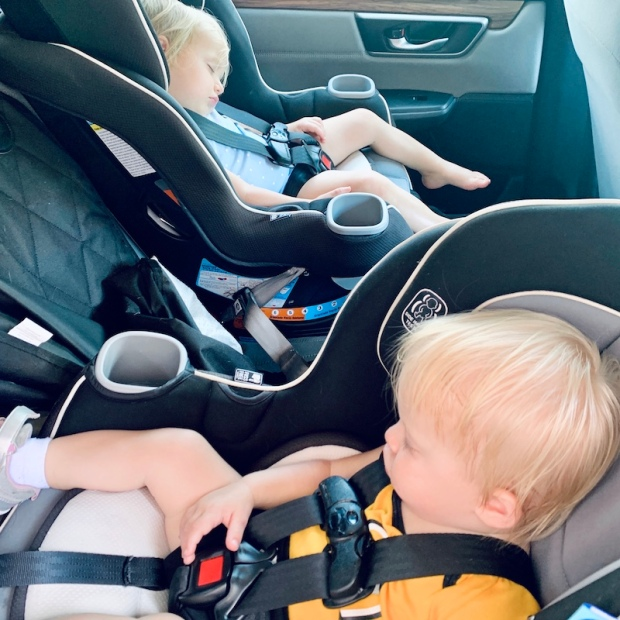 Toddlers sleeping in carseats