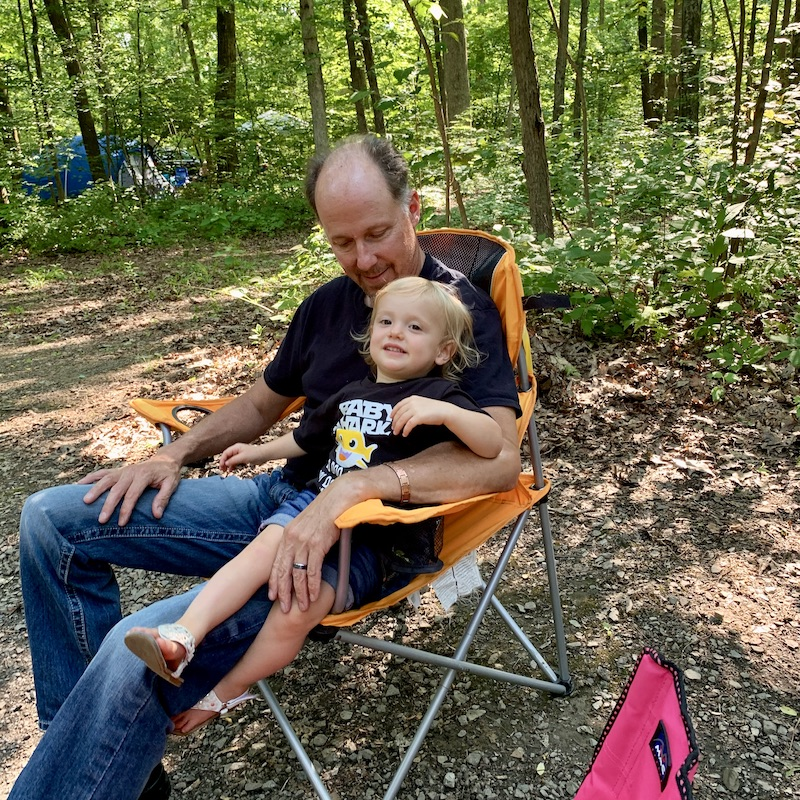 Toddler with grandpa while camping