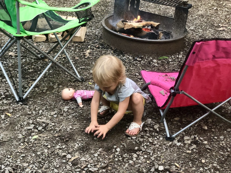 Toddler playing in dirt and rocks while camping at Ohiopyle State Park