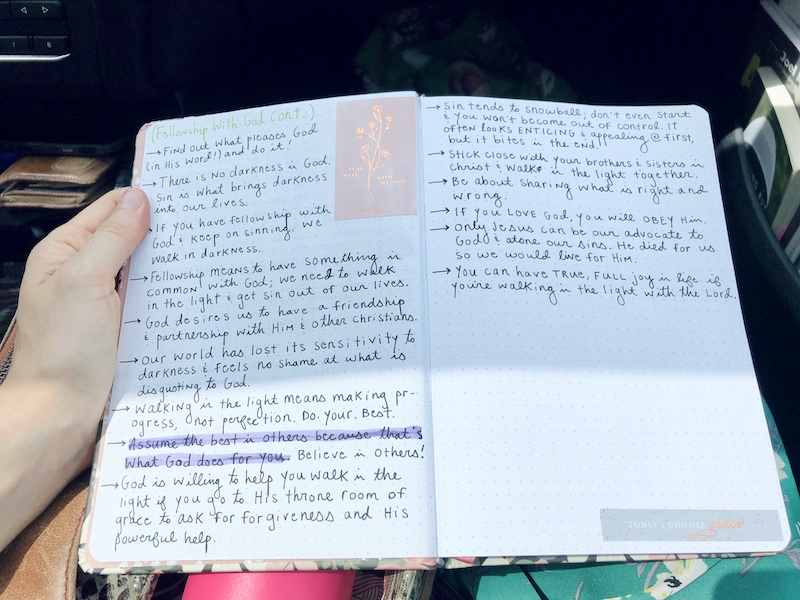 Sermon notes in dot grid journal with Christian stickers for Bible journaling