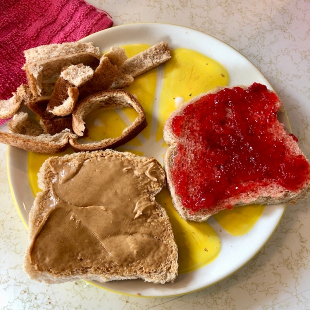 Peanut butter and jelly sandwich with crusts taken off
