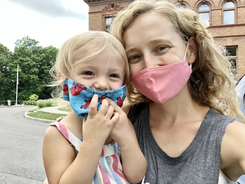 Mom and toddler with masks on