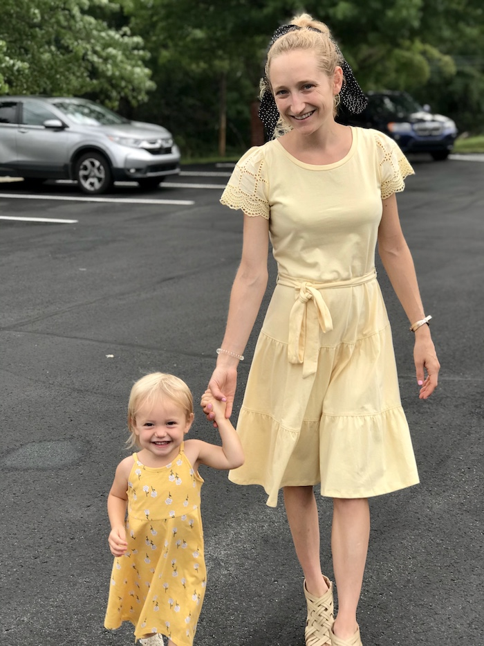 Mom and toddler wearing yellow dresses