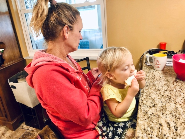Toddler eating Smucker's Uncrustables