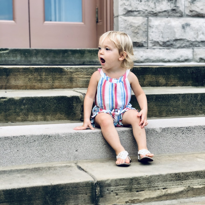 Toddler on library steps in Carnegie Pittsburgh Library