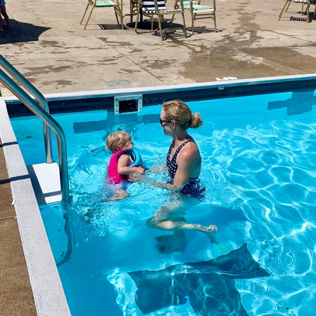 Mom and toddler swimming