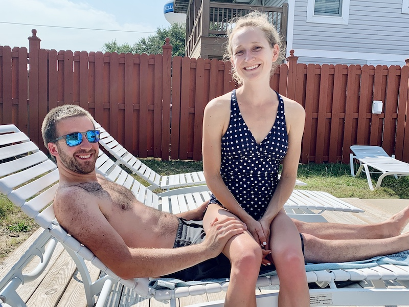 Couple sitting by pool in Outer Banks