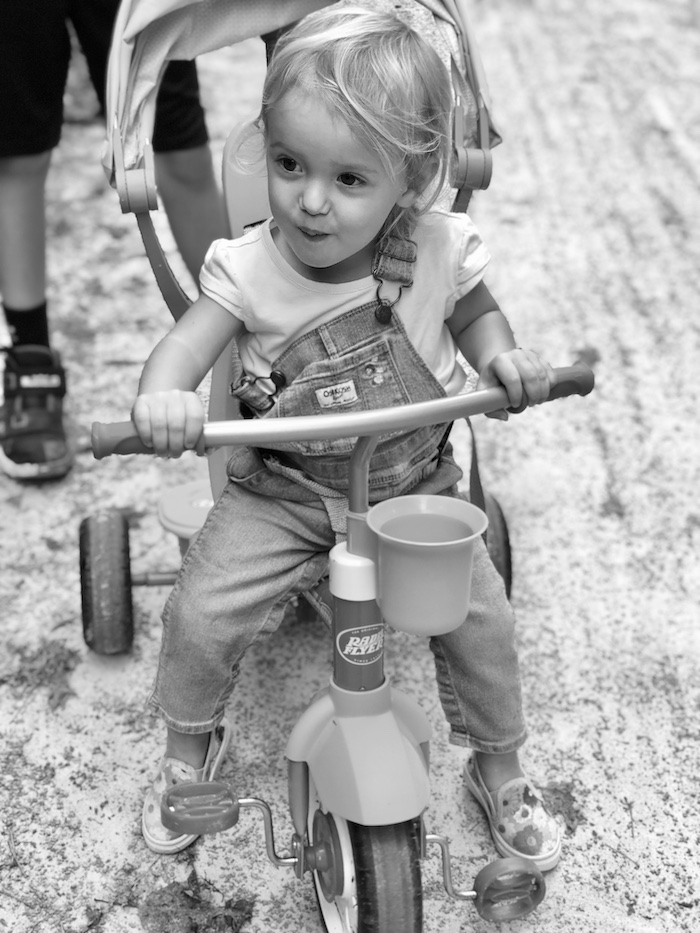 Toddler girl riding Radio Flyer tricycle