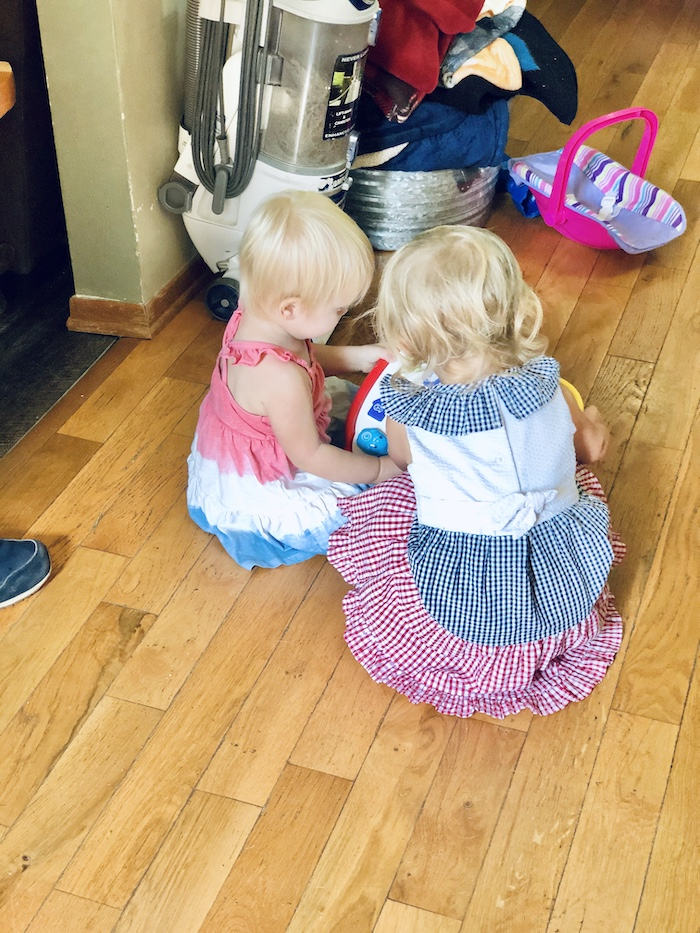 Toddlers in red white and blue dresses playing together