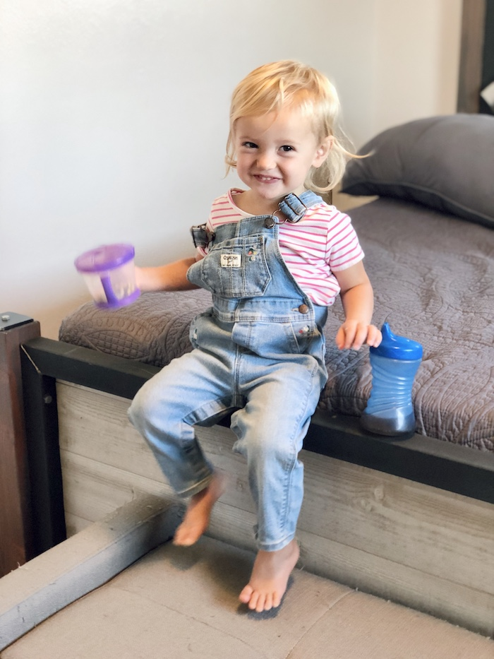 Toddler in overalls