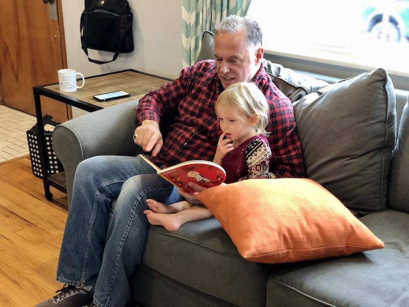 Grandpa reading to grandchild