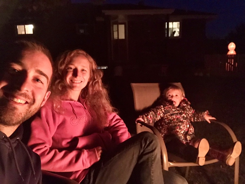 Family sitting around bonfire