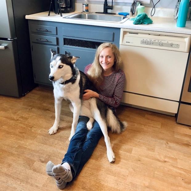 Husky sitting on girl