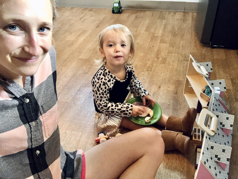 Mom and daughter picnic on the floor